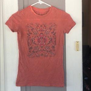 A pinkish orange aeropostale shirt!
